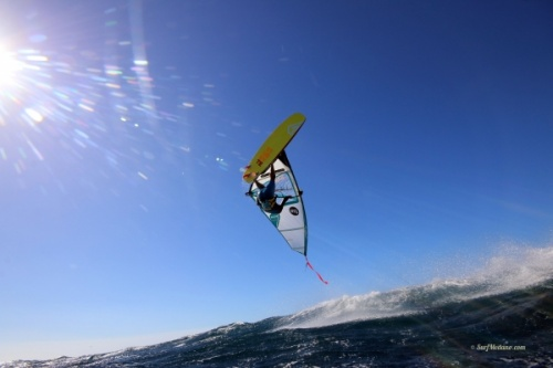Wave windsurfing flying Friday back loop at El Cabezo in El Medano